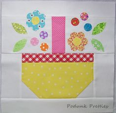 Learn how to make a quilt quickly with this adorable and easy quilt block pattern. Combining scrap quilting and fusible applique, the Spring Basket Quilt Block Pattern is easy-to-make and a charming way to use up old scraps. Use this easy quilt block pattern to make a mini quilt or combine it with other quilt block patterns to create a spring quilt to brighten up your home. No matter how you decide to use this pattern, you are going to love the result.