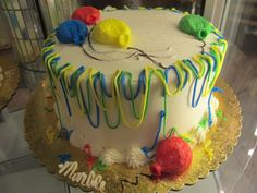 Fun birthday cake idea from Zehnder's of Frankenmuth with playful frosting balloons and streamer-like frosting design around the edges.#ZFun #marble #vanillafrosting #cake #Frankenmuth #Zehnders #birthday #specialty #desserts #party #streamers #cooldesign #ZBakery