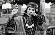 1920's. An Ainu woman playing the Mukkuri (ムックリ, a Jew's harp). The Mukkuri is a traditional Ainu musical instrument played by women. It is made of carefully cut bamboo with two strings, and measures about 10 by 1.5 cm (3.9 by 0.6 inches). The player vibrates the tongue cut out of the bamboo by pulling one of the strings, while holding the instrument in front of the mouth. Volume and tone colors are changed by changing the shape of the mouth.