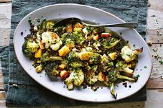 Jamie Oliver's hearty salad is the perfect combination of warm, roasted veg with haloumi and lentils - the crowning side to any family feast, or a meal on its own.
