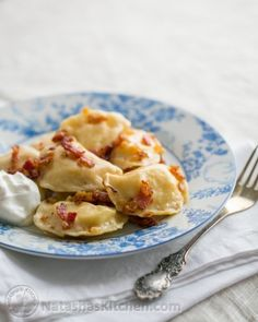 Pierogies are THE comfort food of Europe. Loaded with cheesy mashed potatoes and topped with bacon. Ukrainian Recipes, Russian Recipes, Slovak Recipes, Ukrainian Food, Russian Dishes, Pierogi Recipe, Good Food, Yummy Food, Delicious Dishes