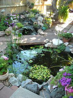 stone bridge across the water. Very small pond.