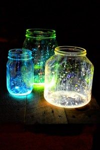 Mason jars with glow stick liquid drizzles; I can almost hear the bass and dance beat.    Variation on the glitter jars. Could be on food and check-in tables.