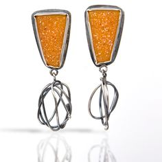 """One of a kind,sunset orange (it's a color now!) drusy earrings with  oxidized silver pods at the bottom, capture the essence of sunset on the  beach. Silver posts. Length- 2"""" width- 5/8""""."""