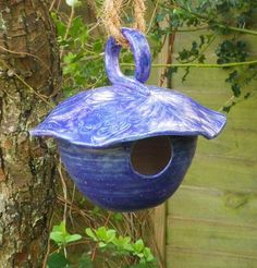 Bird house, nesting box or feeder in stoneware--fully weatherproof.