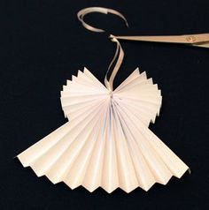Easy Angel Crafts Accordian Folded Paper Angel Ornament Step 10 tie ribbon