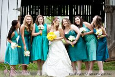 I love different shades of teal or turquoise for the bridesmaids dresses.  The yellow thrown in is a very funky and bright look. -- which is deffff the colors i'm doing one day :)