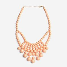 "Cascade Bubble Statement NecklacesMain material: Acrylic/ResinChain Material: Gold Plated AlloyAcrylic Color: PeachChain Length: 2"" (adjustable)Lead and Nickle Free"