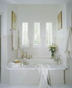 Like the combination marble and bead board tub surround.