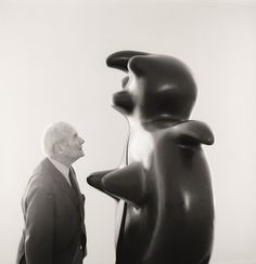 Joan Miró with his work, Femme, at the Galerie Maeght, Paris, 1970.