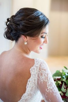 Stunning classic chignon and low back lace wedding gown. | Jillian Joseph Photography