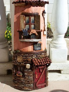http://detrapoybarro.blogspot.co.uk/p/tejas-decoradas-artesanales.html