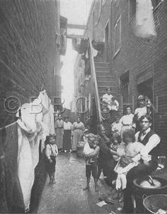 Families in an alley. Starr Centre Association of Philadelphia, c.1909. Image courtesy of the Barbara Bates Center for the Study of the History of Nursing.