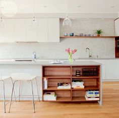 white kitchen + wood shelves