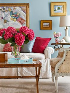 Colorful Classic Living Room.  Love the art and pop of color.  I love that table!