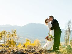 newlyweds kissing in colorado mountains