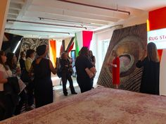 The Champagne Curated Tour pays a visit to @starkcarpet exhibition of rugs by Rug Star, designed by Jurgen Dahlmans - curator Judy Afia explains that 'the sheer detail & colour on these rugs is truly unique' #Focus16