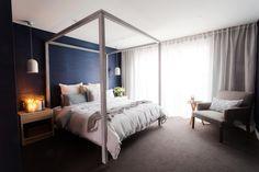 Blue grass cloth wallpaper l Large artwork in bedroom l Four post bed l Luxury bedroom