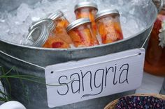 Ready to drink sangria (or cocktails) in sealed mason jars placed in a tub of ice. Love this idea for a summer party.