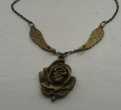 Antique bronze rose necklace with angel wings by RosieMays on Etsy