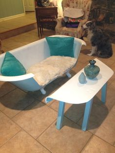 Tub couch and table...I'VE SEEN CLAWFOOTED TUBS MADE INTO A COUCH BUT NOT THE TABLE...neat idea