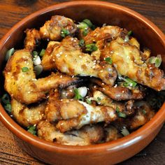 1/2 cup smooth peanut butter                     1/3 cup soy sauce                     1/4 cup water                     2 tablespoons canola oil, plus more for oiling the grill grate                     1-tablespoon sesame seeds                     20 chicken wings, rinsed and thoroughly patted dry                     1 scallion, finely chopped