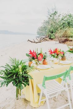 DIY paint-dipped chairs for a tropical beach wedding // Tropical With a Hint of Neon: A Styled Shoot by the Beach {Facebook and Instagram: The Wedding Scoop}