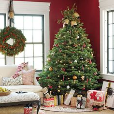 Colorful Classic Christmas Tree - - Visit http://www.southernliving.com/holiday-home for more Christmas decorating ideas