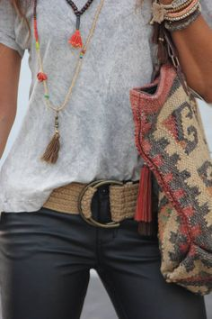 Black skinnies, grey top with Aztec print bag and jewelry.