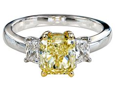 Gordon James Three Stone Fancy Colored Diamond Ring featuring a Cushion Cut Yellow Diamond with Trapezoid Cut Diamonds