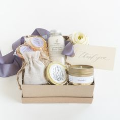"""Marigold & Grey's """"Luxe Lavender"""" gift box design appeals to all the senses. Perfect as a thank you gift, wedding welcome gift, hostess gift, bridesmaid gift, housewarming gift, client gift, corporate gift, bridal shower gift and more!  Source: https://www.marigoldgrey.com/shop/pre-designed-gifts.html"""