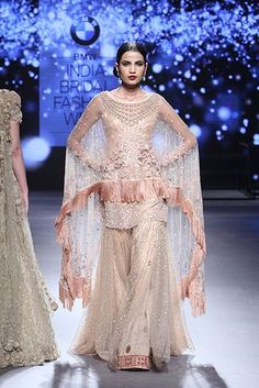 Pakistani women cannot abstain from loving new fashion dress styles of These clothes are having beautiful Designer Cape Style Shirt Designs Pakistani Bridal Wear, Pakistani Wedding Dresses, Pakistani Outfits, Indian Dresses, Indian Outfits, Bridal Dresses, Nikkah Dress, Mehndi Dress, Tarun Tahiliani