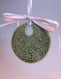 Celadon Swirl Ornament in Porcelain by PotterybyLisa on Etsy Ceramic Pendant, Ceramic Jewelry, Ceramic Beads, Ceramic Clay, Clay Jewelry, Ceramic Pottery, Clay Ornaments, Holiday Ornaments, Ceramic Christmas Decorations