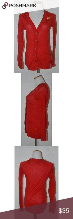 """Marc by Marc Jacobs Poppy Red Cardigan Gold Bow 100% cotton. Good preowned condition.  Length - 26.75"""" Arm pit to arm pit - 16"""" Sleeve length - 25.5"""" Marc By Marc Jacobs Sweaters Cardigans"""