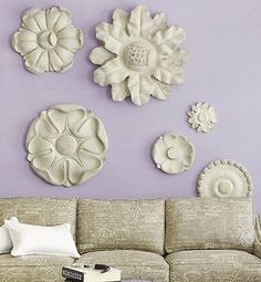Ceiling medallions were often used to suspend chandeliers in older homes, but their intricate, architectural details can also add character to your walls. Use a variety of sizes and styles—from rosettes to roped coils—to create a custom montage that'll look like it was built right in.