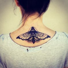 Realistic 3d black ink moth tattoo on back