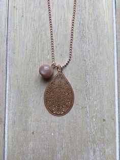 Long rose gold colored ball chain necklace with filigree