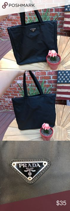 Prada Black Nylon Tote Bag 100% Authentic  Name of Bag - Prada Nylon Tote Bag Bought at $450 Reselling because I only wore it a few times No issues other than a dot stain at the top back of the bag  Height is 12.5 inches excluding the height from the top of the bag to the shoulder which is 8 inches stretched out as much as it can be Width is 12.5 inches  I previously sold 2 Chloé bags on here which were 100% real and got a 5 star rating on both so I promise this one is Authentic too! Prada…