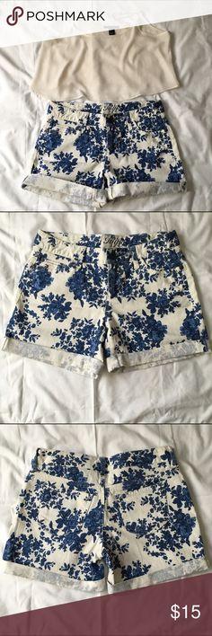 Tommy Hilfiger floral shorts Tommy Hilfiger floral shorts. White with blue floral pattern. Cuffed. Size 2. Never worn. Tommy Hilfiger Shorts Jean Shorts