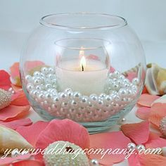 pearls in vases, with flowers instead of candles