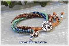 SUNFLOWER SEED BEAD LEATHER WRAP BRACELET/ SUNFLOWER WRAP BRACELET/ SEED BEAD BRACELET/ BEADED LEATHER WRAP/ BOHO LEATHER BRACELET. YOU HAVE YOUR CHOICE OF MANY BUTTONS. IF THERES AN ITEM WITH A PARTICULAR BUTTON YOUD LIKE ON ANOTHER LEATHER WRAP BRACELET, PLEASE LET ME KNOW.