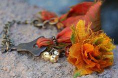 Upcycled boho sari silk bracelet with key and silk flower focal point. $45.00, via Etsy.