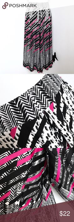 """NY Collection Geometric Culottes These are black, pink, and white culottes with a geometric print. They resemble a a full skirt, but wear like a pant. These calf length culottes have a 3 pleat front and are very soft and stretchy. Material is polyester/spandex blend.  Size: 2X Inseam: 21.5"""" Length: Approximately 33""""  In great condition. NY Collection Pants Wide Leg"""