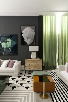 So many textures and patterns in this living space. We love those dramatic, sheer green curtains.