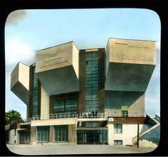 A hand-colored lantern slide of the Rusakov Workers' Club, an icon of the early Soviet Union's Constructivist architecture, taken in 1931 by American travel photographer Branson DeCou. Built in 1928, the three concrete wedges each house a small auditorium that can be combined into one.