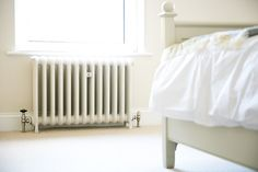 School cast iron radiator painted in buttermilk against a backdrop of Farrow and Balls Slipper Satin Bedroom Radiators, Victorian Terrace House, Cast Iron Radiators, Farrow Ball, House Tours, Master Bedroom, It Cast, Home Appliances, Interior