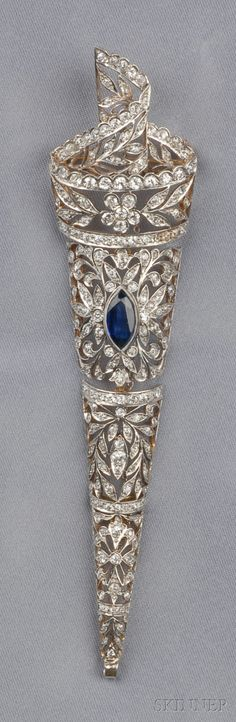 Diamond and Sapphire Pendant/Brooch, bezel-set with a marquise-cut sapphire further bead and bezel-set with single and old European-cut diamond melee, approx. total diamond wt. 3.65 cts, platinum-topped gold mount, lg. 5 in. Edwardian or Edwardian style