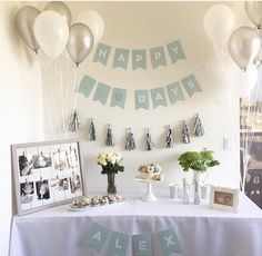 Pictures on whiteboard, tablecloth over cube unit Simple 1st Birthday Party Boy, Baby Boy Birthday Decoration, Simple Birthday Decorations, First Birthday Party Themes, Birthday Themes For Boys, Baby Boy First Birthday, Boy Birthday Parties, Bebe 1 An, 100 Day Celebration