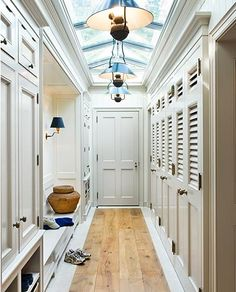 Mudroom with great storage, bench, lighting, skylight, cubbies