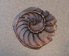Very cool Polymer Clay Ammonite tutorial!  http://www.beading-arts.com/2009/08/copprclay-ammonite-pendant-part-one.html